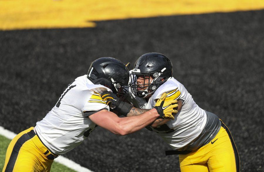 Iowa defensive lineman Lukas Van Ness (left) and defensive lineman Noah Shannon (right) run drills during Iowa football spring practice on Saturday, April 17, 2021 in Kinnick Stadium.