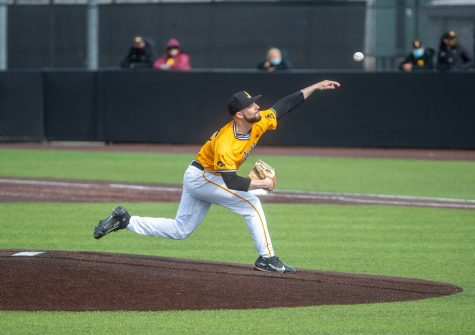 Iowa pitcher Cam Baumann throws a pitch during a baseball game between Iowa and Northwestern on Sunday, April 25, 2021 at Duane Banks Field. The Hawkeyes defeated the Wildcats 15-4. (Jerod Ringwald/The Daily Iowan)
