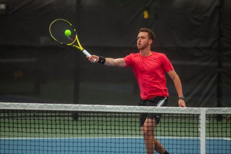 Iowa's Kareem Allaf returns the ball during a men's tennis meet between Iowa and No. 14 Illinois on Friday, April 9 at the Hawkeye Tennis and Recreation Complex. The Fighting Illini defeated the Hawkeyes 5-2.