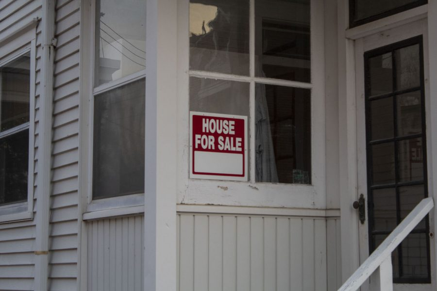 A For Sale sign is seen on Nov. 17, 2020. With families wanting larger homes to inhabit while being stuck at home due to COVID-19, real estate companies are doing notably well.