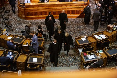 Members of the Iowa Supreme Court exit the house chamber following the State of the State address at the Iowa State Capitol on Tuesday, Jan. 12, 2021 in Des Moines. Gov. Reynolds highlighted in the address expansion of broadband internet, a push for in-person learning, and economic recovery from the COVID-19 pandemic.