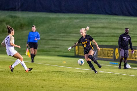 Iowa defender Samantha Cary navigates the field during a women
