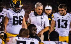 Iowa head coach Kirk Ferentz and Defensive Line Coach Kelvin Bell talk to the team during a football game between Iowa and Iowa State at Jack Trice Stadium in Ames on Saturday, September 14, 2019. The Hawkeyes retained the Cy-Hawk Trophy for the fifth consecutive year, downing the Cyclones, 18-17.