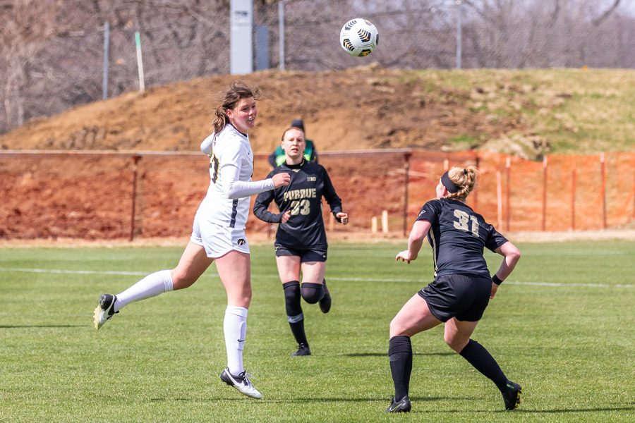 Iowa Forward Samantha Tawharu heads the ball during the Iowa Soccer senior day game against Purdue on Mar. 28, 2021 at the Iowa Soccer Complex. Iowa defeated Purdue 1-0.