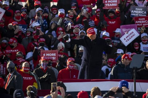 "President Donald Trump dances during a ""Make America Great Again"" rally held at the Dubuque Regional Airport on Sunday, November 1, 2020. With two days before Election Day, this is President Trump's second stop to Iowa in the past few weeks."