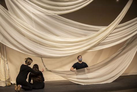 "Cast members rehearse while curtains drape over the stage during a dress rehearsal of ""Ascend,"" in the Mabie Theatre at the Theatre Building on March 31, 2021. ""Ascend"", directed by Margarita Blush and written/created by the cast and creative team, explores the growth of individuals, especially after the pandemic. There will be a virtual performance of ""Ascend"" on April 28, 2021."