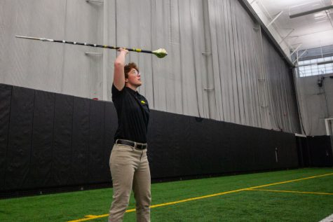 "Amanda Thomas, University of Iowa Hawkeye Marching Band Drum Major, performs inside the Hawkeye Tennis and Recreation Complex on Wednesday April 7, 2021. ""I am beyond excited to get started,"" Thomas said."