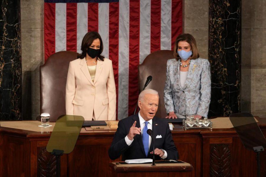 Apr 28, 2021; Washington, DC, USA; U.S. President Joe Biden addresses a joint session of Congress as Vice President Kamala Harris (L) and Speaker of the House U.S. Rep. Nancy Pelosi (D-CA) (R) look on in the House chamber of the U.S. Capitol April 28, 2021 in Washington, DC