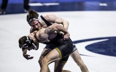 Iowa's Michael Kemerer attempts to escape against Penn State's Carter Starocci during the finals of the Big Ten Wrestling Tournament at the Bryce Jordan Center in State College, PA on Sunday, March 8, 2021. Kemerer won the match by decision 7-2. This is Kemerer's first Big Ten Title.