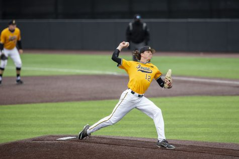 Iowa pitcher, Drew Irvine, pitches the ball to a Minnesota player during the Iowa baseball game v. Minnesota at the Duane Banks Field in Iowa City on April 11, 2021.