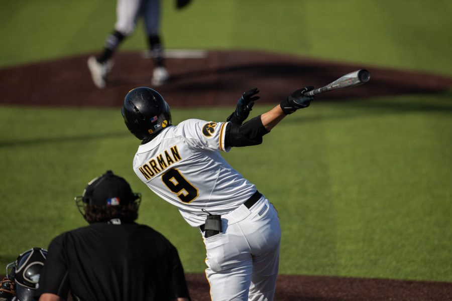Iowa baseball player Ben Norman hits the ball during a baseball game in Iowa City against Northwestern on April 26. The Hawks beat the Wildcats, 9-8.