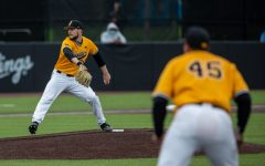 Iowa starting pitcher Cam Baumann pitches during a baseball game between Iowa and Minnesota at Duane Banks Field on Sunday, April 11, 2021. The Hawkeyes defeated the Gophers 18-0.