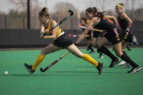 Iowa forward Maddy Murphy attempts to shoot at the empty goal during the fourth quarter of a field hockey game against Maryland on Sunday, April 4, 2021 at Grant Field. The Hawkeyes defeated the Terrapins, 3-0. With 12 minutes left of the game, Maryland decided to pull their goalkeeper to replace the position with another player on offense, but switched back to having a goalkeeper after 10 minutes of game play.
