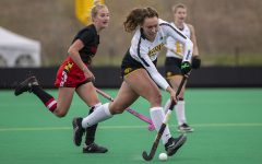 Iowa midfielder Harper Dunne runs up the field with the ball during the fourth quarter of the Big Ten field hockey tournament quarterfinals against No. 4 Maryland on Wednesday, April 21, 2021 at Grant Field. The Hawkeyes defeated the Terrapins, 3-0. No. 5 Iowa will go on to play No. 1 Michigan tomorrow afternoon.