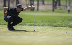 Iowa's Alex Schaake lines up a shot during the men's golf Hawkeye Invitational on Saturday, April 17, 2021 at Finkbine Golf Course. (Hannah Kinson/The Daily Iowan)