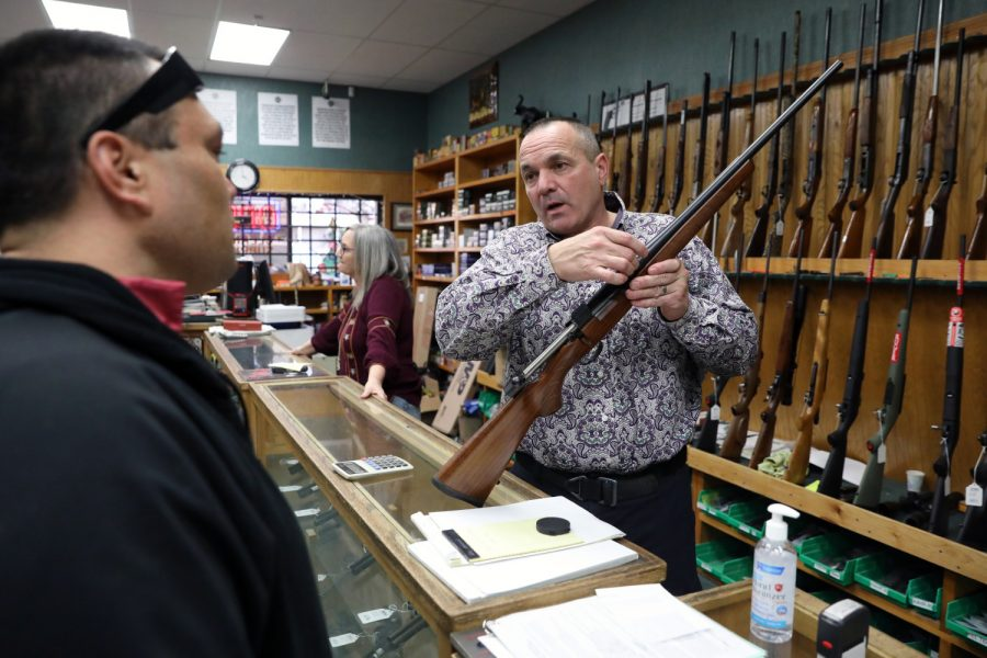Shasta County Supervisor Patrick Jones, 52, at his gun shop in Redding on Thursday, Jan. 7, 2021. Jones, newly elected, unlocked the doors to the supervisors' chambers to hold an unauthorized in-person meeting to protest statewide COVID-19 restrictions.