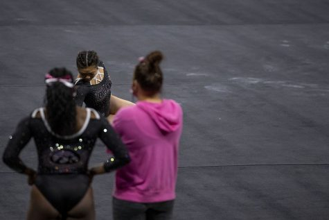 Iowas Clair Kaji gets ready to perform her floor routine during a gymnastics meet against Ohio State on Saturday, Jan. 23, 2021 at Carver Hawkeye arena. The Hawkeyes defeated the Buckeyes with a score, 196.550-193.800. Kaji earned a score of 9.925.