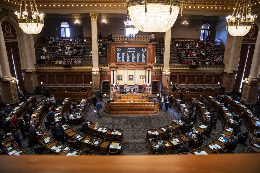 Members of the Iowa house prepare for the opening of the 2021 legislative session on Monday, Jan. 11, 2021 at the Iowa State Capitol in Des Moines. Legislative goals for the session include further tax cuts, expanding in-person learning, and moving towards economic recovery from the COVID-19 pandemic.