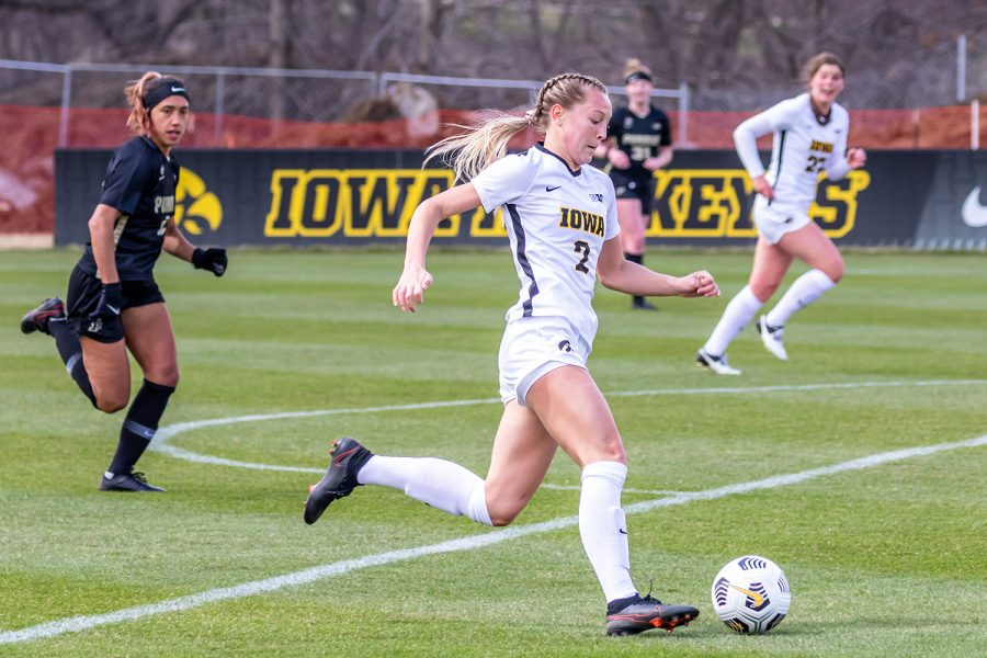 Iowa+Midfielder+Hailey+Rydberg+runs+the+ball+down+the+field+during+the+Iowa+Soccer+senior+day+game+against+Purdue+on+Mar.+28%2C+2021+at+the+Iowa+Soccer+Complex.+Iowa+defeated+Purdue+1-0.