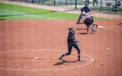 Iowa pitcher Allison Doocy throws a pitch with a runner on first during a softball game at Pearl Field on Saturday, April 3 during a softball game between Iowa and Indiana. The Hawkeyes defeated the Hoosiers 8-0 in five innings.