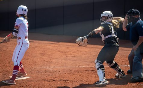 Iowa catcher Lindy Milkowski attempts to pick off a runner on third after a strike during a softball game at Pearl Field on Saturday, April 3 during a softball game between Iowa and Indiana. The Hawkeyes defeated the Hoosiers 8-0 in five innings.