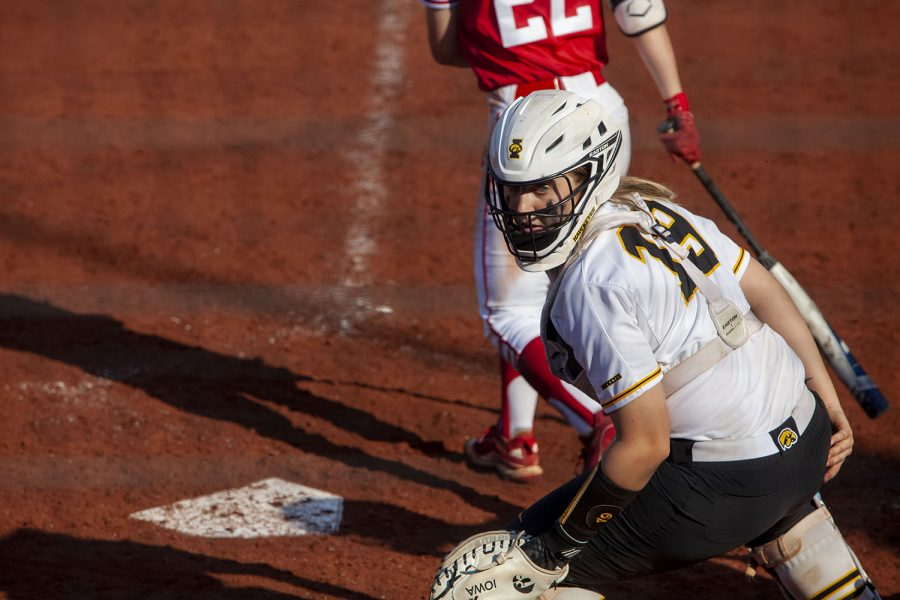 Iowa catcher Lindy Milkowski searches for a loose ball during a softball game between Iowa and Indiana at Bob Pearl Softball Field on Sunday, April 4th. The Hawkeyes defeated the Hoosiers 2-1 in extra innings.