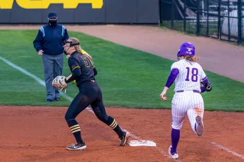 Iowa utility player Denali Loecker steps on the base to get Northwestern's pitcher/utility player Morgan Newport out during the Iowa Softball game against Northwestern on April 17, 2021 at Bob Pearl Field. Northwestern defeated Iowa 7-4.
