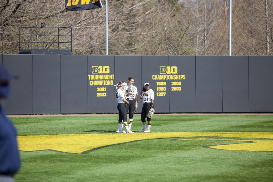 (left to right) Iowa's Riley Sheehy, Brylee Klosterman and Nia Carter confer during a softball game between Iowa and Indiana at Bob Pearl Softball Field on Sunday, April 4th. The Hawkeyes defeated the Hoosiers 2-1 in extra innings