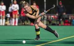 Iowa midfielder Nikki Freeman passes the ball during the second quarter of a field hockey game against Maryland on Friday, April 2, 2021 at Grant Field. The Hawkeyes were defeated by the Terrapins, 1-0.