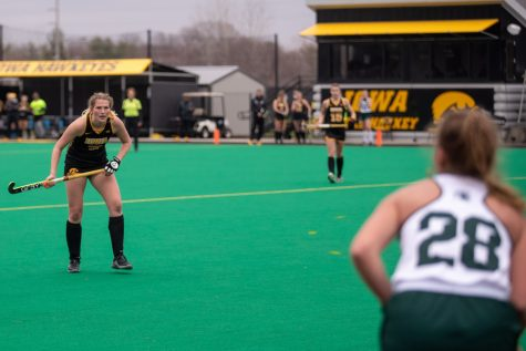 Iowa Midfielder Ellie Holley stares down Michigan State midfielder Ellie Wheatley during a field hockey game between Iowa and Michigan State at Grant Field on Friday, March 26, 2021. The Hawkeyes beat the Spartans 5-0.