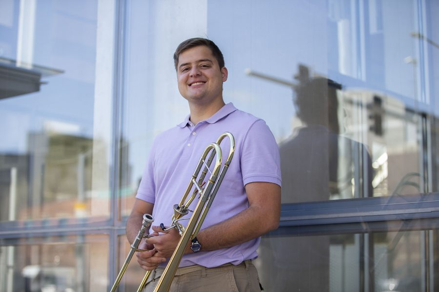 Masters+student+studying+trombone+performance%2C+Ben+Hahn%2C+poses+for+a+portrait+outside+of+Voxman+Music+Building+at+the+University+of+Iowa.+Hahn+is+a+finalist+for+an+international+solo+competition+organized+by+the+International+Trombone+Association%2C+and+will+be+playing+in+the+final+round+this+summer.+