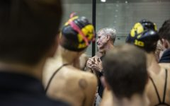 Iowa Head Coach Marc Long gives a speech to his swimmers after a swim meet at the CRWC on January 11, 2020 between Iowa, Illinois, and Notre Dame. The Hawkeye men's team defeated the fighting Irish 159.50 to 140.50 while the Hawkeye women's team defeated the fighting Illini 223 to 86 and lost to the fighting Irish 99.50 to 209.50.