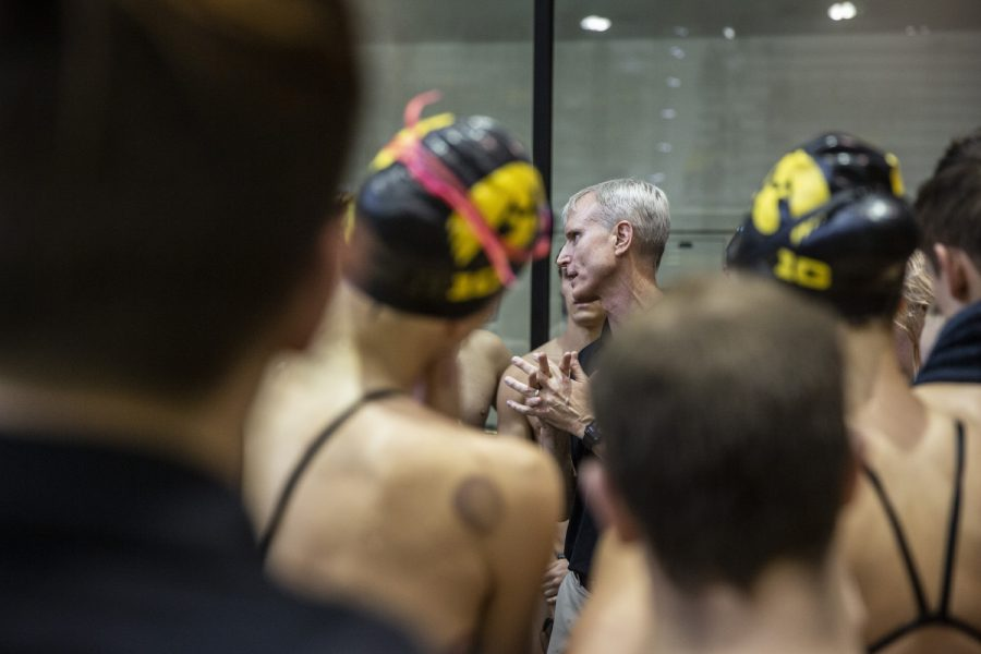 Iowa Head Coach Marc Long gives a speech to his swimmers after a swim meet at the CRWC on January 11, 2020 between Iowa, Illinois, and Notre Dame. The Hawkeye mens team defeated the fighting Irish 159.50 to 140.50 while the Hawkeye womens team defeated the fighting Illini 223 to 86 and lost to the fighting Irish 99.50 to 209.50.