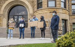 A group of protesters gather outside of the Johnson County Courthouse to advocate for Iowa City resident, Naa Adjeiwa Tackie on Monday, April 19, 2021.