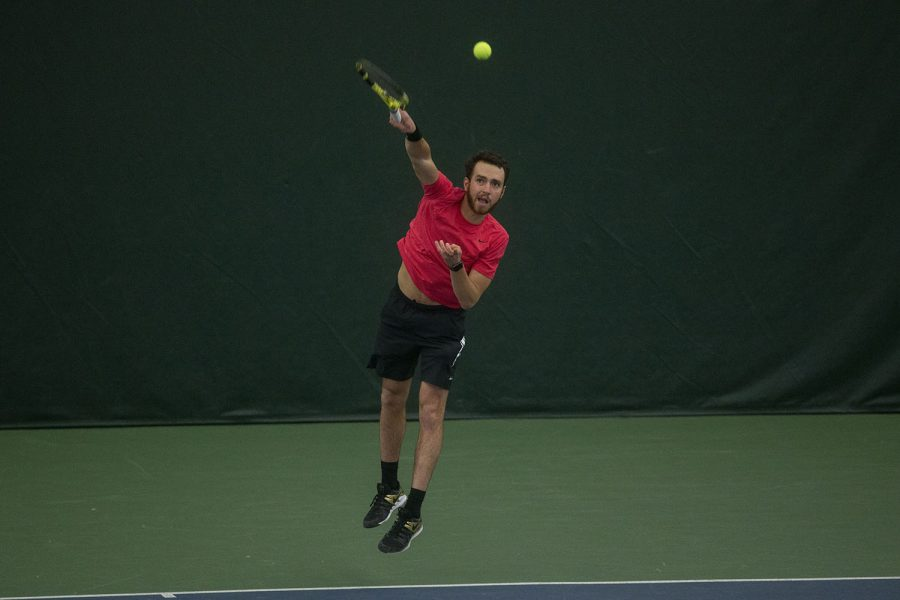 Iowa's Kareem Allaf serves the ball during the Iowa Men's tennis meet v. Wisconsin in the Hawkeye Tennis and Recreation Complex on Friday, March. 12, 2021. The Hawkeyes defeated the Badgers 5-2.