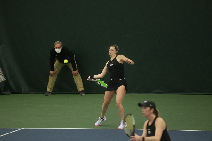UI's Alexa Noel prepares to hit the ball at the women's tennis meet against Nebraska on Sunday, March 28, 2021. The meet was the labeled as