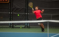 Iowa's Will Davies hits the ball during a men's tennis meet between Iowa and No. 14 Illinois on Friday, April 9, 2021 at the Hawkeye Tennis and Recreation Complex. The Fighting Illini defeated the Hawkeyes 5-2.