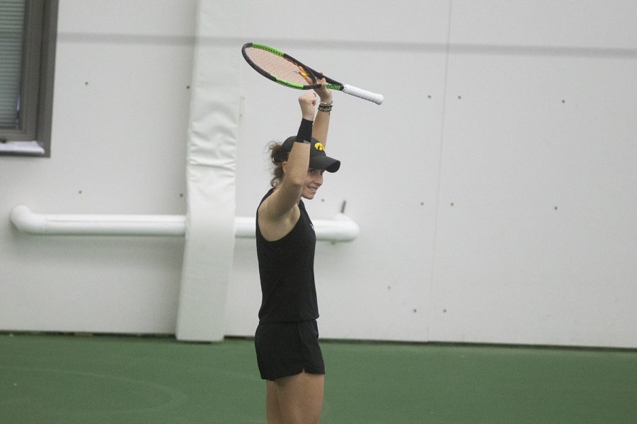 UI senior Elise van Heuvelen Treadwell pumps her fists after winning her singles match at the women's tennis meet against Nebraska on Sunday, March 28, 2021. The meet was the labeled as