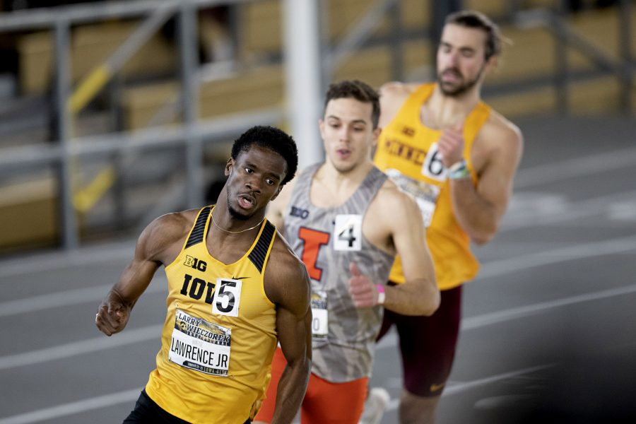 Iowa sprinter Wayne Lawrence Jr. leads the pack in the 400m dash premier during the second day of the Larry Wieczorek Invitational on Saturday, Jan. 23, 2021 at the University of Iowa Recreation Building. Lawrence won with a time of 46.28. Due to coronavirus restrictions, the Hawkeyes could only host Big Ten teams. Iowa men took first, scoring 189, and women finished third with 104 among Minnesota, Wisconsin, Nebraska, and Illinois.