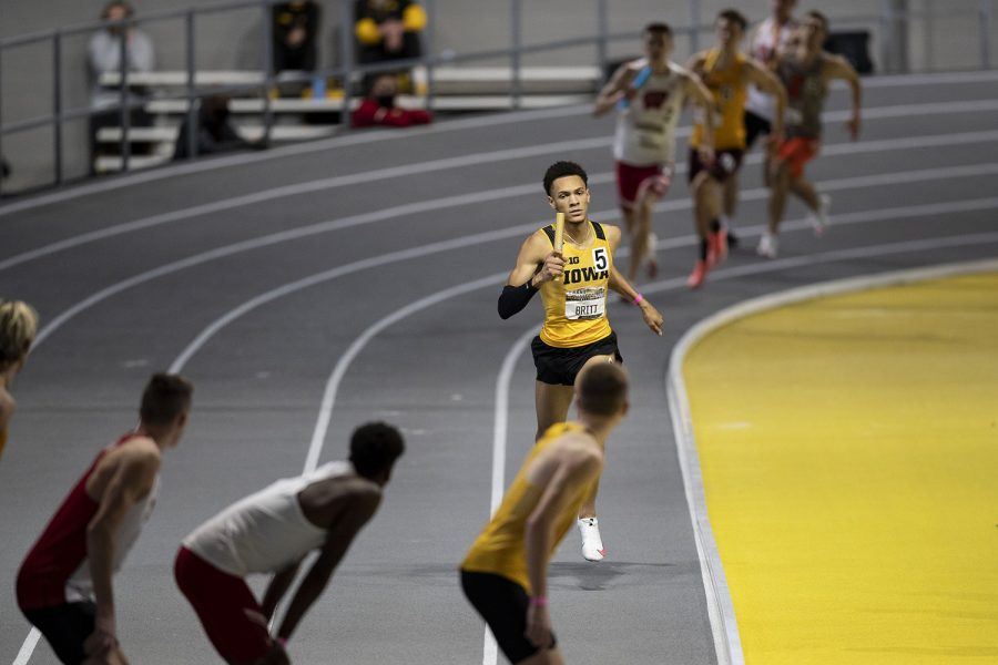 Jamal Britt finishes his leg of the 4x400m relay premier during the second day of the Larry Wieczorek Invitational on Saturday, Jan. 23, 2021 at the University of Iowa Recreation Building. Britt ran a split of 48.375, contributing to the Iowa 'A' team victory with a total time of 3:09.58. Due to coronavirus restrictions, the Hawkeyes could only host Big Ten teams. Iowa men took first, scoring 189, and women finished third with 104 among Minnesota, Wisconsin, Nebraska, and Illinois.