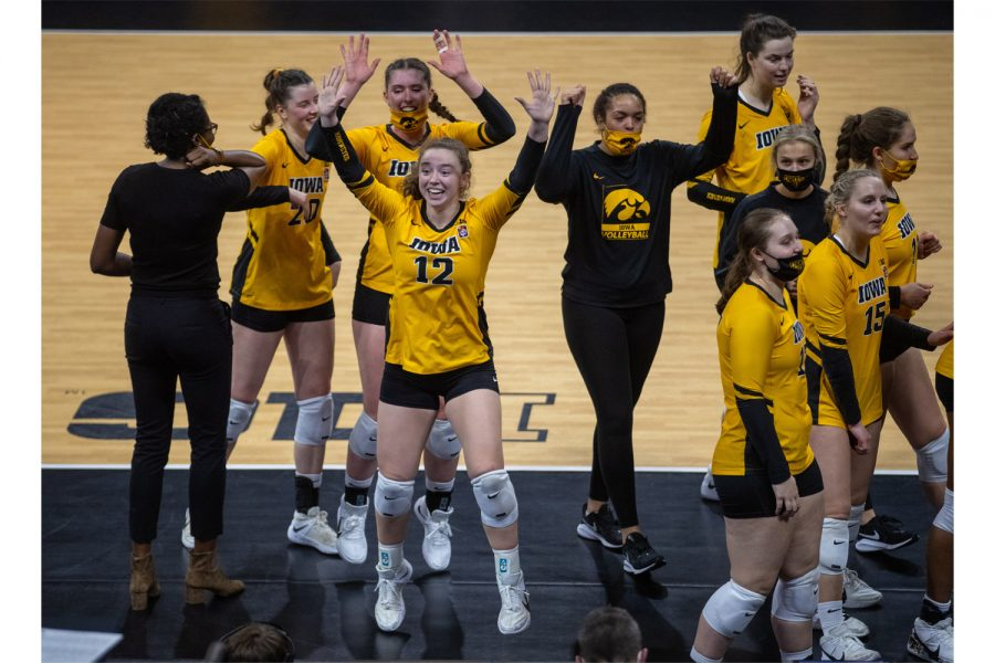 Iowa Setter Bailey Ortega jumps up after a win during a volleyball match between Iowa and Michigan State at Carver-Hawkeye Arena on Saturday, March 27, 2021. The Hawkeyes defeated the Spartans 3-0.