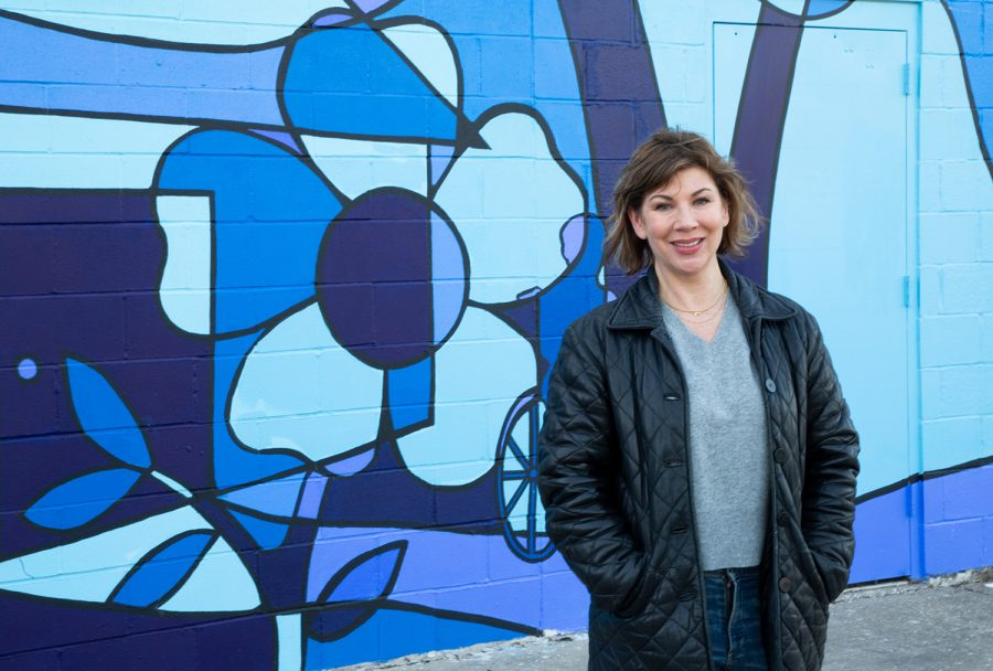 Megan Alter poses for a portrait on Friday, April 2, 2021 in front of the Broadway mural in Peppermint Plaza. She announced her second run for Iowa City City Council with a small outdoor gathering.