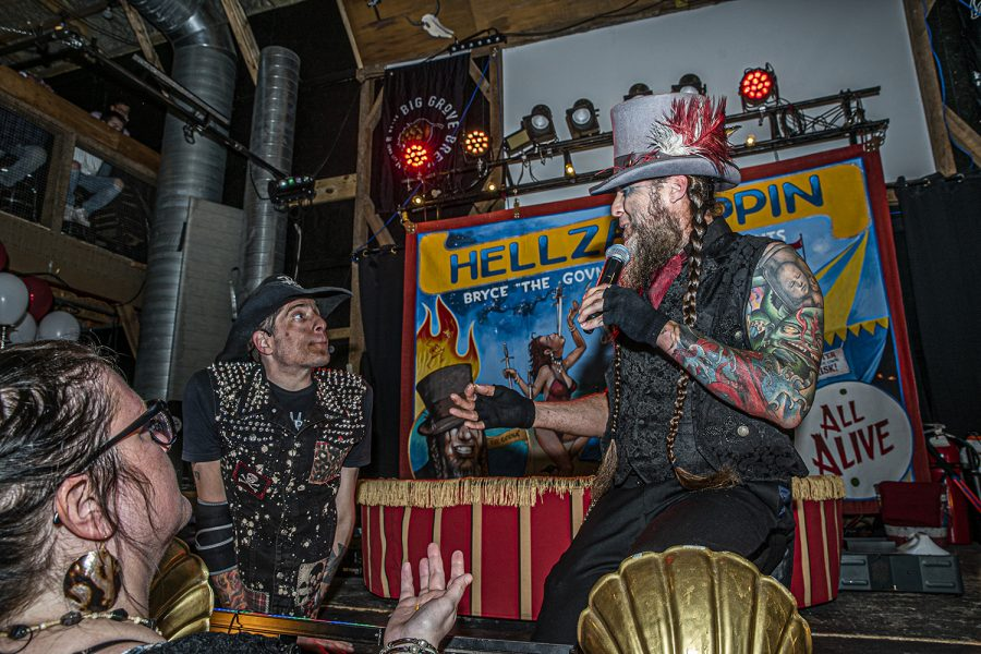 Performers%2C+Bryce+Graves+aka+%E2%80%9CThe+Govna%E2%80%9D++and+Short+E.+Dangerously+aka+%28The+Half+Man%29+perform+as+part+of+Hellzapoppin+Circus+Sideshow+Revue+at+Wildwood+Saloon+on+Saturday%2C+April+3rd%2C+2021.+Hellzapoppin+is+a+touring+act+harkening+back+to+the+days+of+circus+freak+shows+updating+the+concept+for+a+modern+audience.