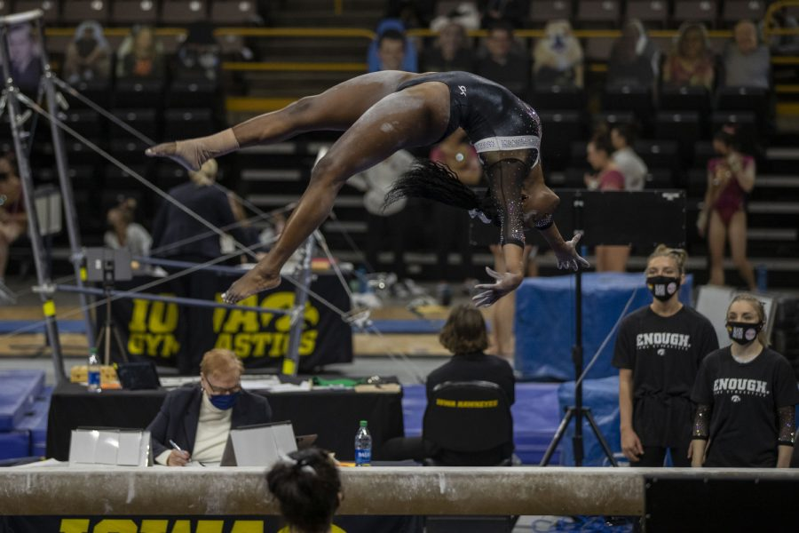 Iowa's all-around JerQuavia Henderson practices on the beam before the competition round during a women's gymnastics meet between Iowa, Minnesota, and Maryland on Saturday, Feb. 13, 2021 at Carver Hawkeye Arena. The Hawkeyes came in second with a score of 196.775 after the Gophers won with 196.975 and Maryland lost with 195.350. Henderson went on to receive a score of 9.875.