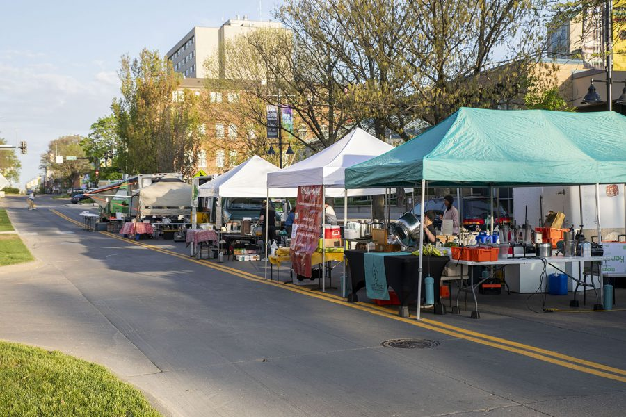 Setting up on Saturday, May 1, 2021. Vendors line E Washington St in preparation for the start of the Iowa City Farmers Market.This is the 1st in-person market since 2020.