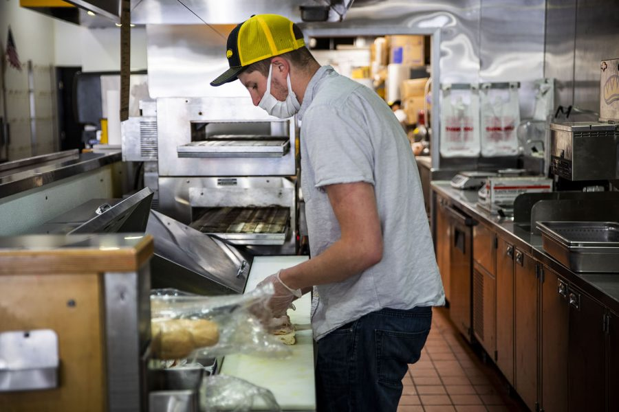 Chris Fisher General Manager prepares a customers sandwich on Wednesday, May 5, 2021.Fisher manages the Which Wich Sandwich Shop in Iowa City.