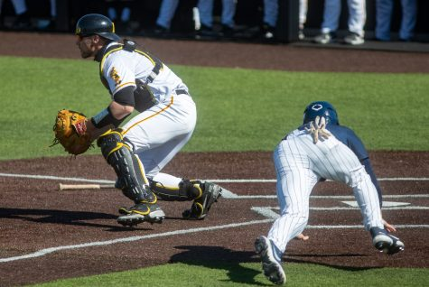Iowa catcher Austin Martin waits for the ball to come in while Penn State scores a run during a baseball game between Iowa and Penn State on Friday, May 7, 2021 at Duane Banks Field. The Hawkeyes defeated the Nittany Lions 4-2.