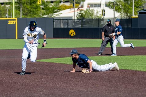 Iowa shortstop Brendan Sher runs to third after a ball gets past Penn State third basemen Justin Williams during a baseball game between Iowa and Penn State on Friday, May 7, 2021 at Duane Banks Field. The Hawkeyes defeated the Nittany Lions 4-2.