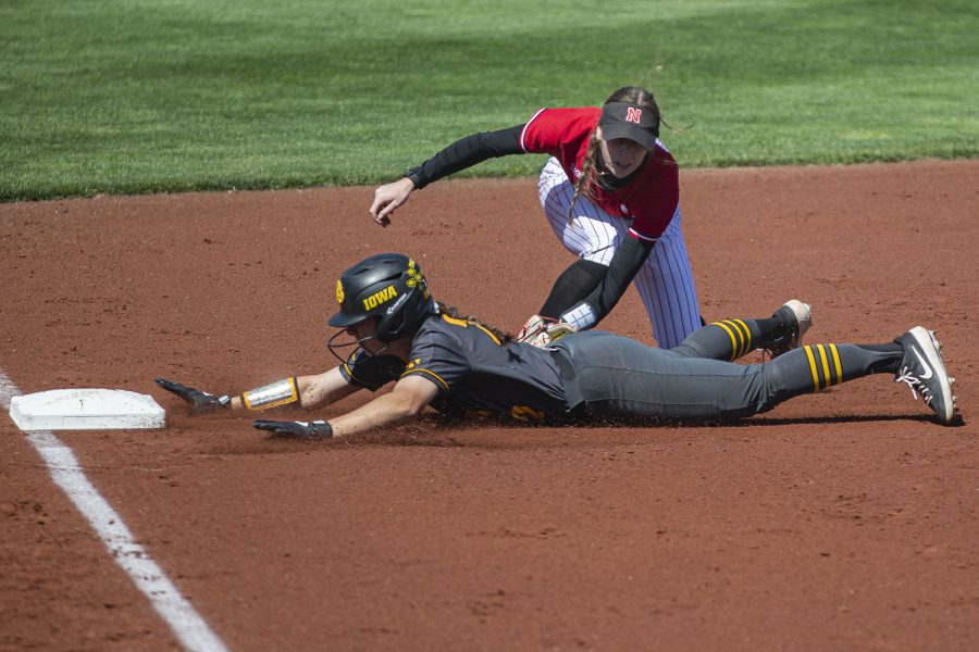 Iowa utility player Brylee Klosterman slides into third base and is tagged out during a softball game against Nebraska on Friday, May 7, 2021 at Pearl Field. The Hawkeyes defeated the Huskers, 1-0.