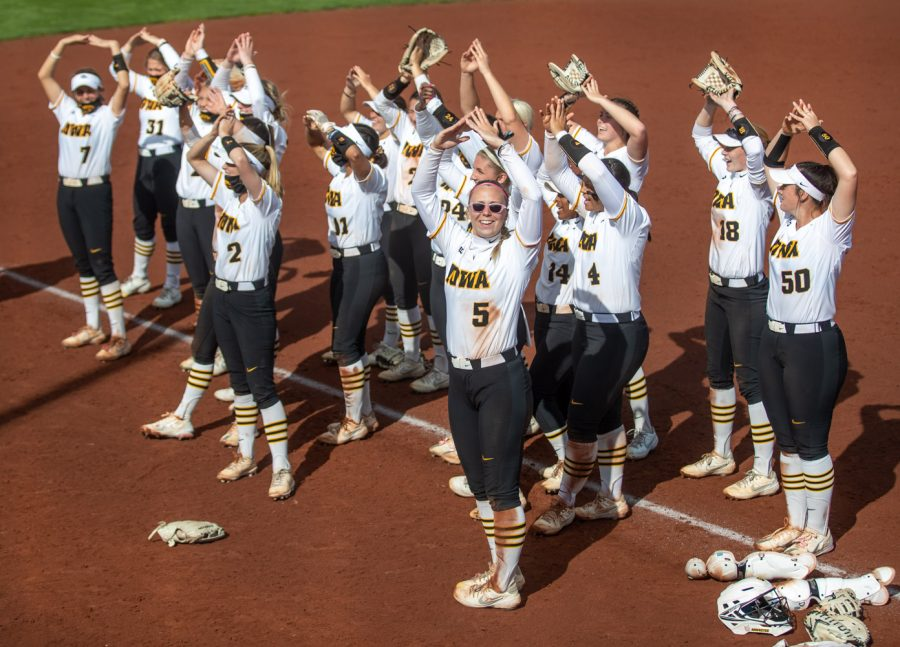 Iowa players lead a chant with fans after a softball game between Iowa and Nebraska on Sunday, May 9, 2021 at Bob Pearl Softball Field. The Hawkeyes defeated the Cornhuskers  4-1.